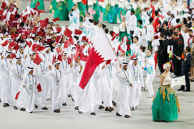 Mubarak Ali Al Morekhe of Qatar carries the country flag during the Opening Ceremony ahead of the 2014 Asian Games at Incheon Asiad Stadium on September 19, 2014