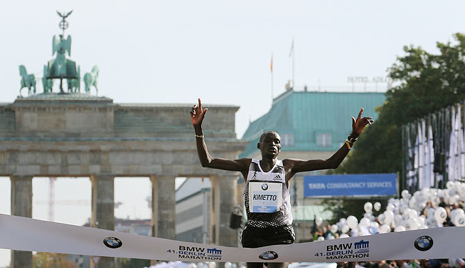 Dennis Kimetto of Kenya crosses the finish line in a new world record time to win the 41st Berlin marathon on Sunday