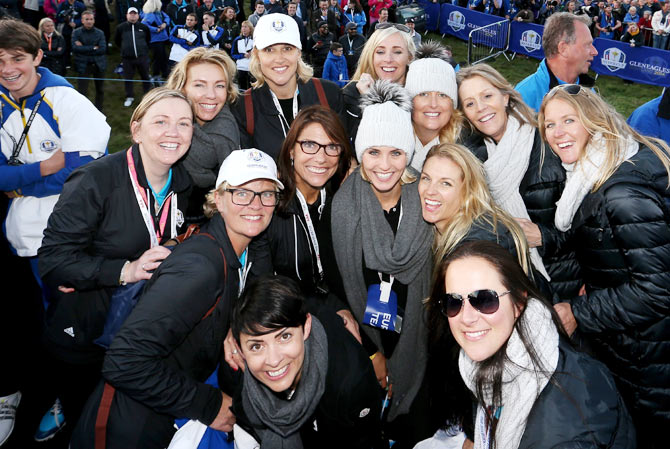 Wives and partners of the Europe Ryder Cup team, Helen Gallacher, Allison McGinley, Pernilla Bjorn, Laurae Westwood, Emma Stenson, Suzanne Torrance, Katharina Boehm, Caroline Harrington, Katie Poulter, Kate Rose, Kathryn Tagg, Vicki Smyth and Susanne Jimenez, pose during the Singles Matches