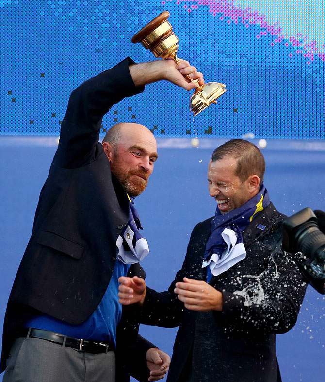 Thomas Bjorn and Sergio Garcia of Europe celebrate winning the Ryder Cup after the Singles Matches
