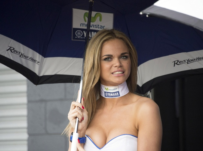 A grid girl poses in paddock
