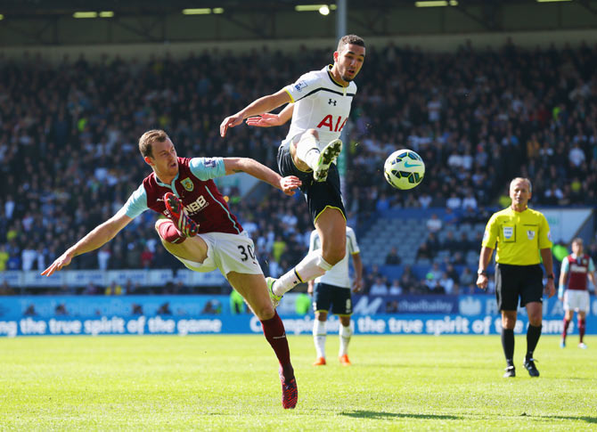 Ashley Barnes of Burnley and Nabil Bentaleb of Spurs battle for the ball during their match at Turf Moor in Burnley on Sunday