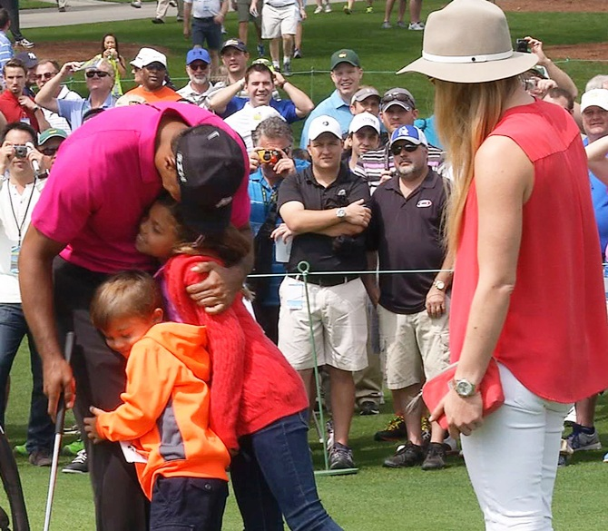 While on the practice area for the 2015 Masters at the Augusta National Golf Course, Tiger Woods gets a hug from daughter Sam and son Charlie. Photograph: Kevin Fogerty/Reuters