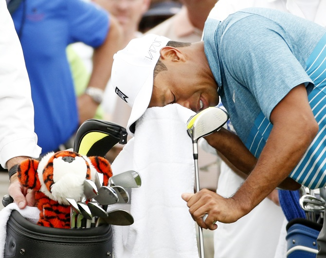 Tiger Woods wipes his face before hitting the first tee during a practice round ahead of the 2015 Masters at the Augusta National Golf Course. Photograph: Phil Noble/Reuters