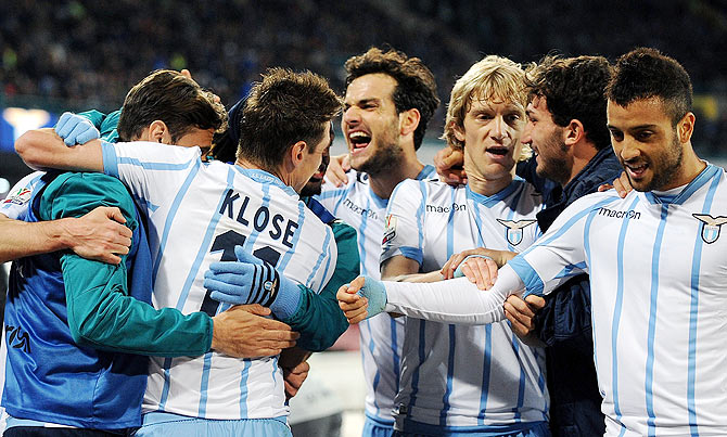 Senad Lulic of Lazio celebrates after scoring the first goal during the Tim cup match between SSC Napoli and SS Lazio