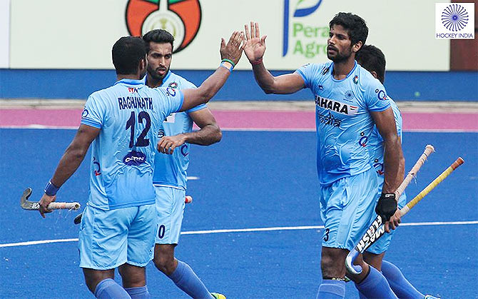 India hockey players celebrate a goal