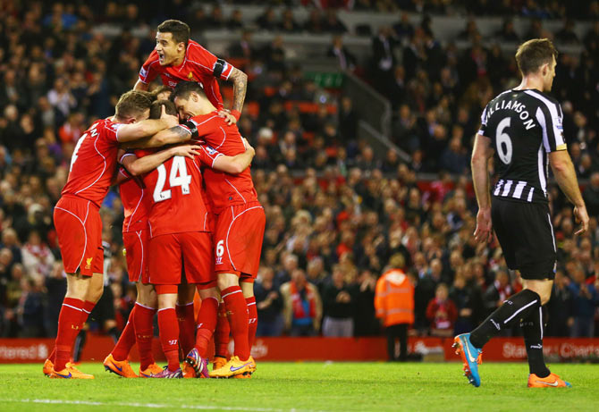 Liverpool players celerbate after Joe Allen scored the winner against Newcastle United during their English Premier League match at Anfield on Monday
