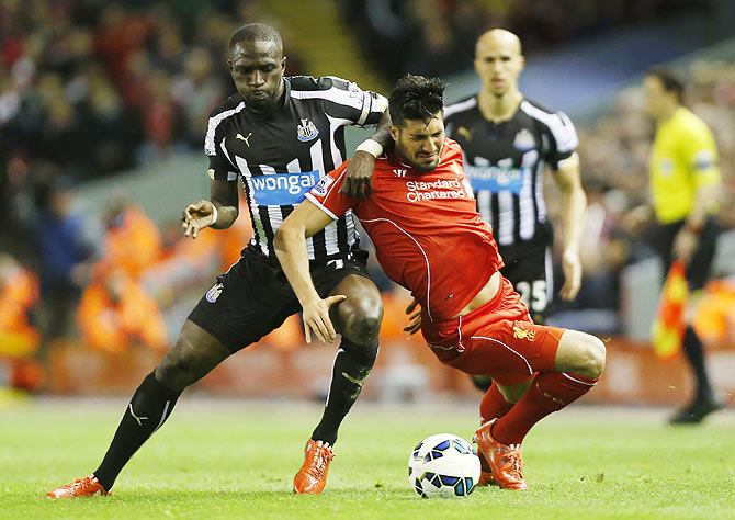 Newcastle's Moussa Sissoko and Liverpool's Emre Can in an intense challenge