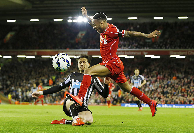 Liverpool's Raheem Sterling in challenged by Newcastle's Daryl Janmaat