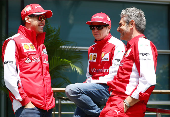 (Right-Left) Ferrari Team Principal Maurizio Arrivabene chats with Kimi Raikkonen and (left) Sebastian Vettel
