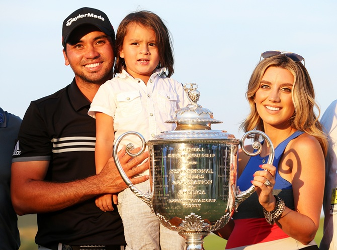Jason Day of Australia poses with the Wanamaker trophy and his wife Ellie and son Dash