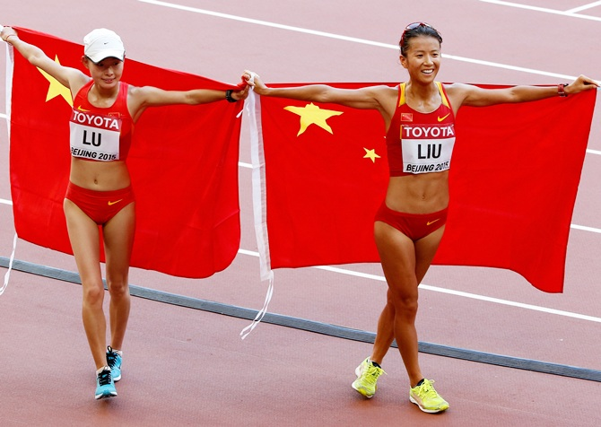 China's silver medalist Xiuzhi Lu, left, and gold medalist Hong Liu celebrate   after the Women's 20km Race Walk final
