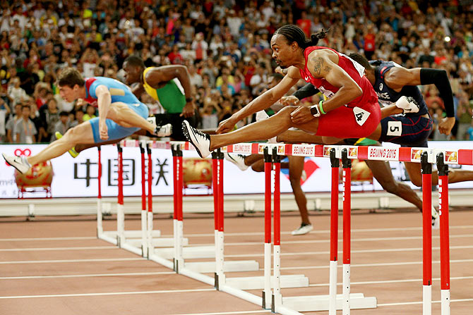 Aries Merritt of the United States competes in the Men's 110 metres hurdles final during day seven of the 15th IAAF World Athletics Championships at Beijing National Stadium on Friday