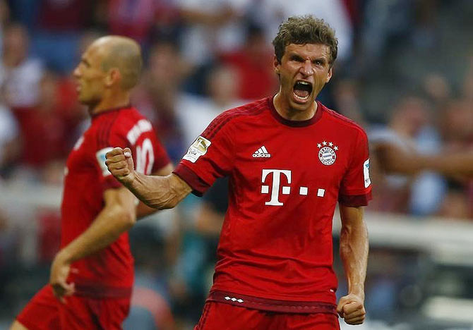 Munich's Thomas Mueller celebrates his goal against Bayer Leverkusen during their German first division Bundesliga match in Munich on Saturday