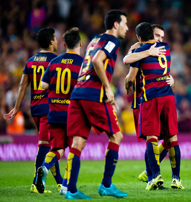 FC Barcelona's Thomas Vermaelen (2nd from right) is congratulated by his temmate Luis Suarez after scoring the opening goal