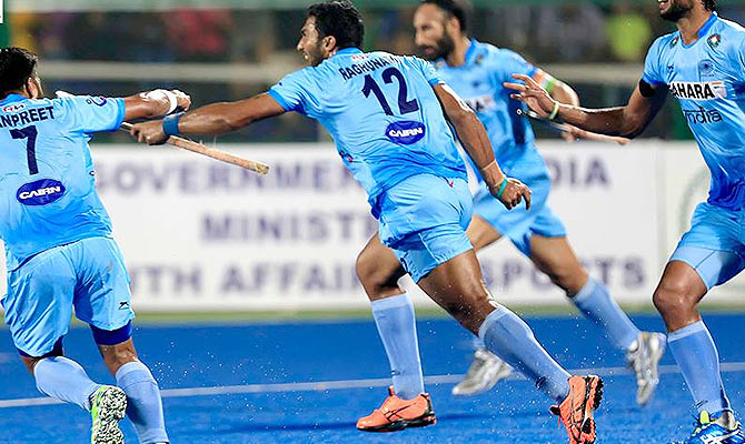 India's VR Raghunath celebrates scoring the first goal against England in their Hockey World League last eight match in Raipur