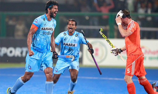 India's Rupinder Pal Singh celebrates scoring the winning goal against the Netherlands during the bronze medal match of the Hockey World League Final in Raipur