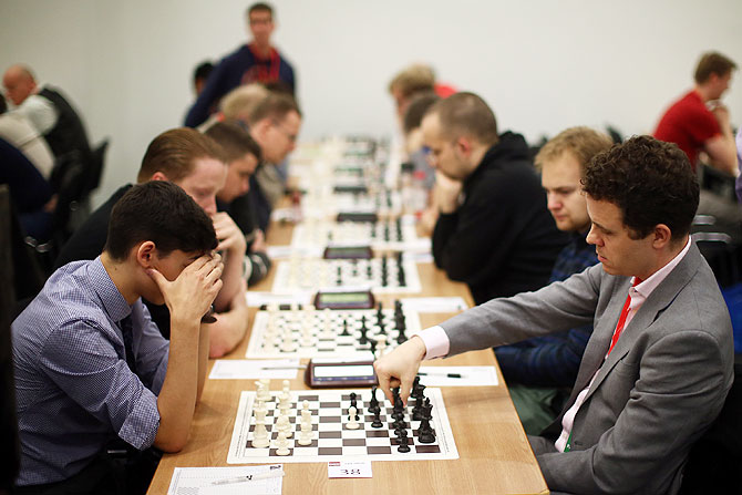 Competitors play in the opening games at the London Chess Classic tournament in London on December 4. As well as a British knockout championship, the tournament will see nine super-grandmasters compete in the final leg of the Grand Chess Tour