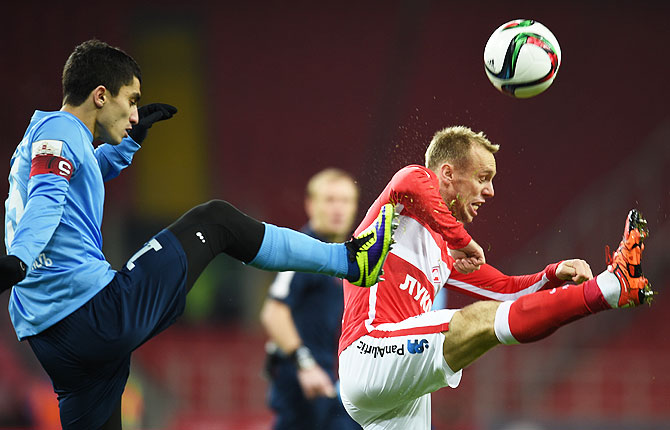 FC Spartak Moscow's Denis Glushakov (right) is challenged by FC Krylia Sovetov Samara's Ibragim Tsallagov during their Russian Premier League match at the Arena Otkritie Stadium in Moscow on December 04