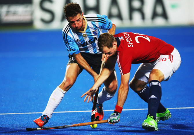 Argentina's Manuel Brunet vies with Great Britain's Dan Shingles during their Hero Hockey League World Final match at the Sardar Vallabh Bhai Patel International Hockey Stadium in Raipur on December 04