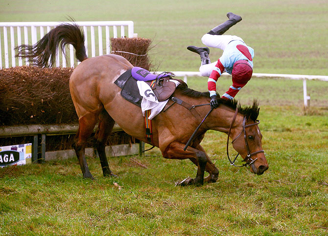 Loch Ard ridden by Miss S Gould falls at the last at Barbury Racecourse in Barbury, England, on December 6
