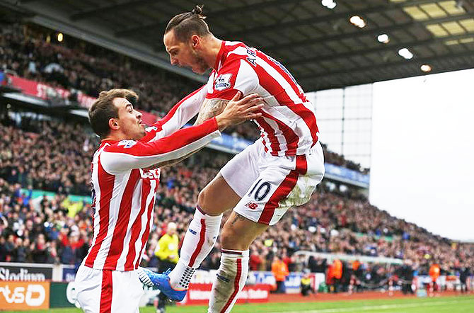 Marko Arnautovic celebrates with Xherdan Shaqiri after scoring the first goal for Stoke City against Manchester City at the Britannia Stadium on Saturday