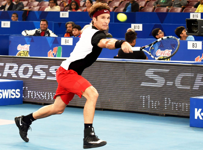 OUE Singapore Slammers' Carlos Moya in action during the International Premier Tennis League (IPTL) match at the IG Stadium in New Delhi on Friday