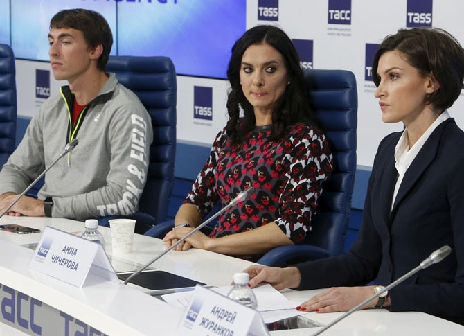 From left, Russian track and field athlete Sergey Shubenkov, pole vaulter Yelena Isinbayeva and high jumper Anna Chicherova attend a news conference in Moscow