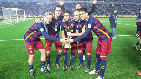 FC Barcelona players celebrate with the Club World Cup trophy
