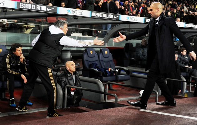 Josep Guardiola (right) greets Jose Mourinho during a Copa del Rey match