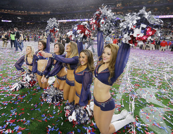 New England Patriots cheerleaders celebrate after their team defeated the Seattle Seahawks in the NFL Super Bowl XLIX football game in Glendale, Arizona on Sunday