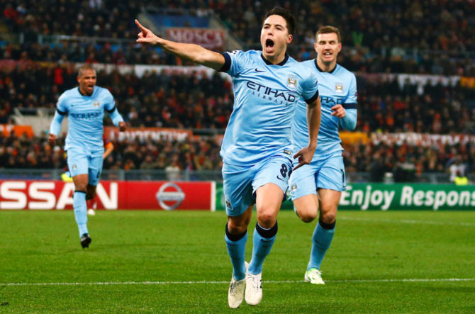 Samir Nasri (centre) celebrates after scoring the first goal for Manchester City