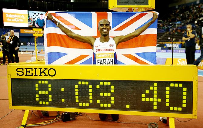 Mo Farah of Great Britain celebrates after breaking the record enroute to winning the mens 2 miles final during the Sainsbury's Indoor Grand Prix at the Barclaycard Arena in Birmingham on Saturday