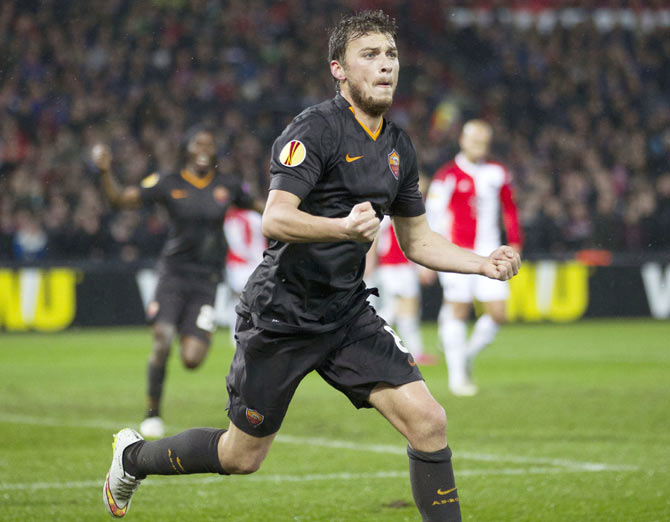 Adem Ljajic of AS Roma celebrates his goal against Feyenoord during their Europa League round of 32 second leg match at the Kuip stadium in Rotterdam