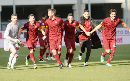 AS Roma players celebrate victory after defeating Udinese Calcio in their Serie A match at Stadio Friuli in Udine on Tuesday