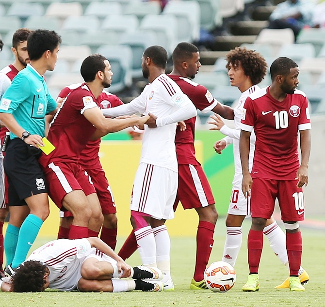 Players react after a foul on Mohamed of the United Arab Emirates