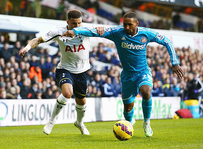 Jermain Defoe of Sunderland takes on Kyle Walker of Tottenham Hotspur during their English Premier League match at White Hart Lane on Saturday