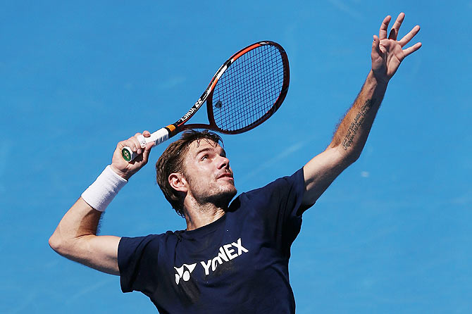 Stanislas Wawrinka of Switzerland serves during a practice session ahead of the 2015 Australian Open at Melbourne Park on Friday