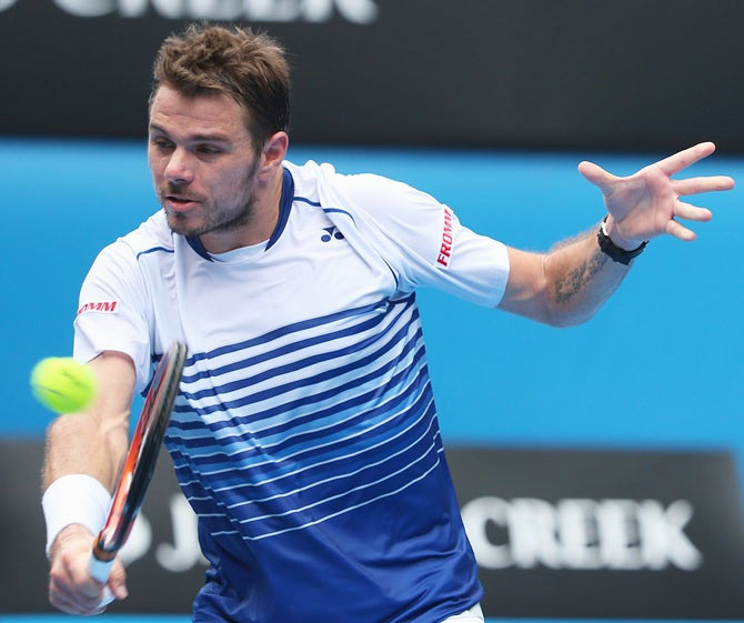 Stanislas Wawrinka of Switzerland plays a backhand in his first round match against Marsel Ilhan of Turkey
