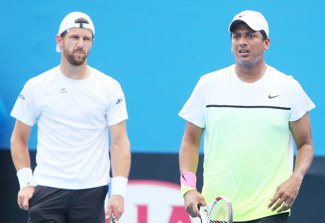 Mahesh Bhupathi of India and Jurgen Melzer of Austria in action in their first round doubles match against Diego Schwartzman of Argentina and Horacio Zeballos of Argentina during the 2015 Australian Open at Melbourne Park on Thursday