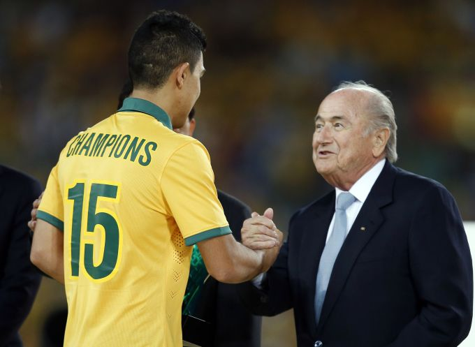 Australia's Massimo Luongo (L) shakes hands with FIFA President Sepp Blatter as he collects the Most Valuable Player award during the trophy presentation ceremony of the Asian Cup