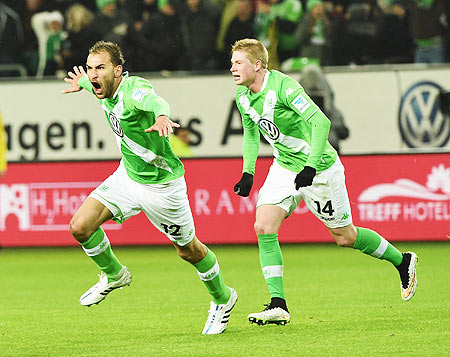 Bas Dost of Wolfsburg celebrates scoring his second goal against FC Bayern Muenchen during their Bundesliga match at Volkswagen Arena in Wolfsburg on Friday