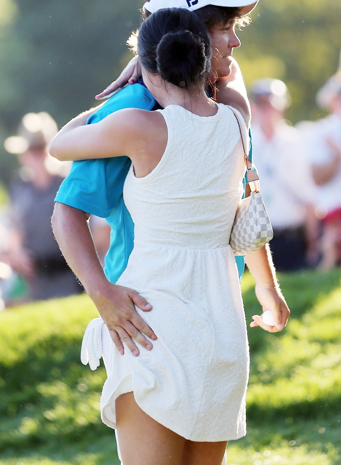 Jason Dufner of the United States hugs his wife Amanda