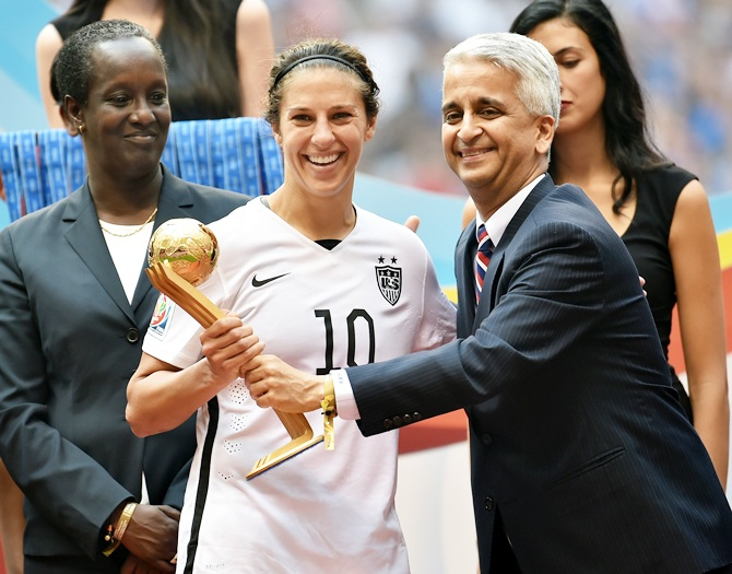 Sunil Gulati, the president of the United States Soccer Federation, poses for a picture with Carli Lloyd