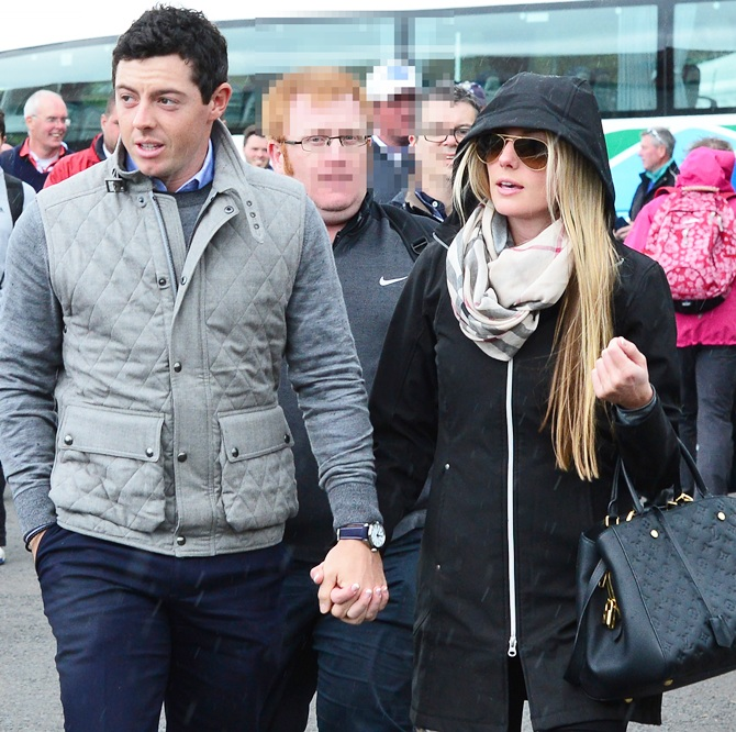 Rediff Sports - Cricket, Indian hockey, Tennis, Football, Chess, Golf - PIX: Golfer McIlroy walks hand-in-hand with girlfriend