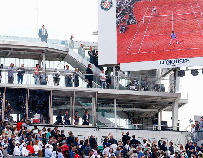 Spectators look to the corner of the court