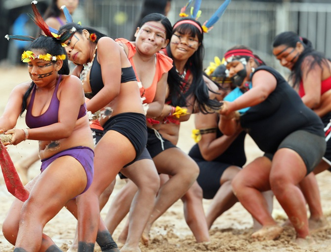 Members of the Brazilian Bororo indigenous ethnic group compete in a tug-of-war