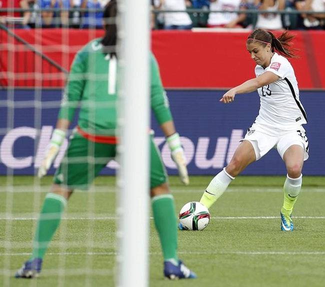 United States forward Alex Morgan scores a goal