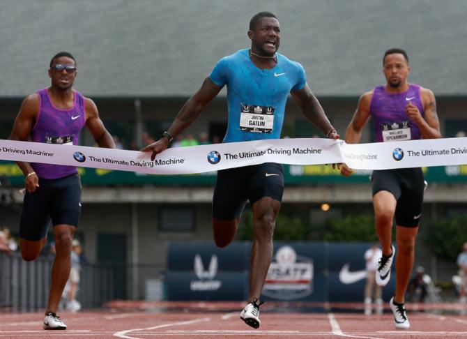 Rediff Sports - Cricket, Indian hockey, Tennis, Football, Chess, Golf - Gatlin sends Bolt a warning after winning 200m in 19.57 at US trials