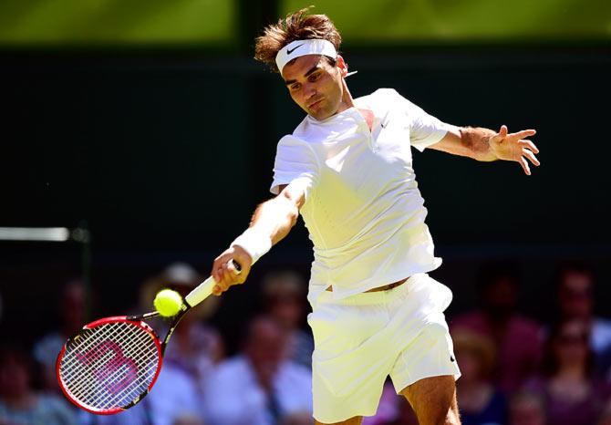 Rediff Sports - Cricket, Indian hockey, Tennis, Football, Chess, Golf - Wimbledon PHOTOS: Federer outclasses Dzumhur, Nadal cruises
